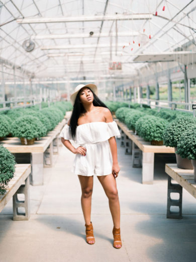 model strikes a pose for a film photographer in a greenhouse called Mulhall's in Omaha, Nebraska
