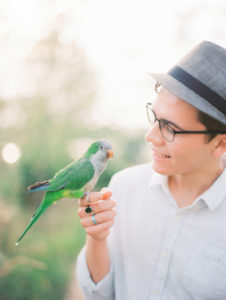 Petri the Quaker parrot and Malachi, by Ashley Crawford Photography