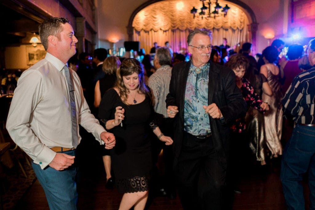 family dancing at a wedding reception