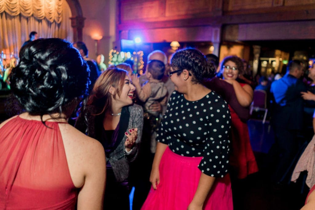 group of people dancing at a wedding reception