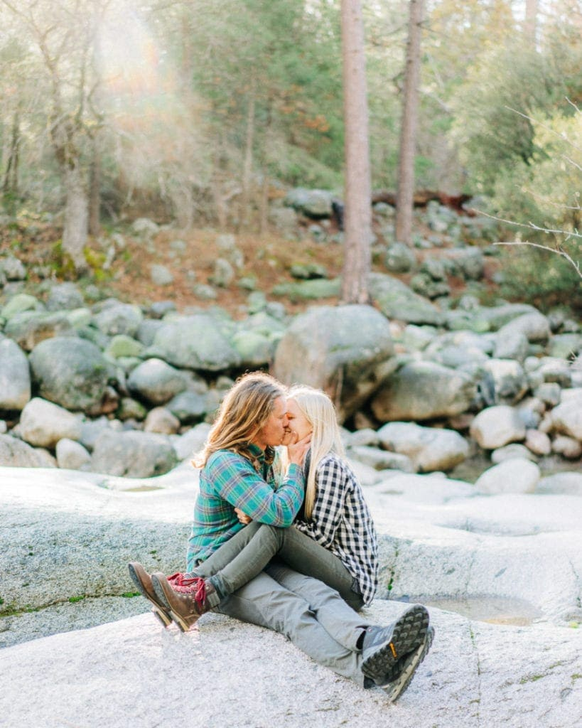 couple kissing on the riverside in Yosemite