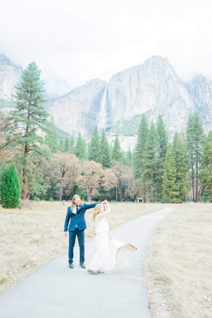dancing in front of Yosemite Falls