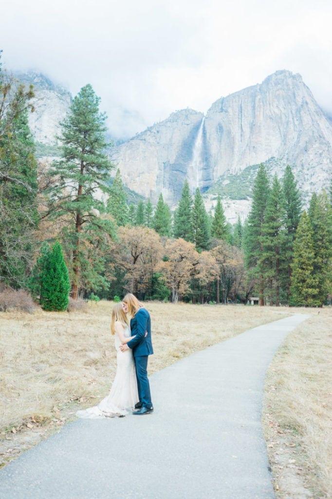 kiss in front of Yosemite Falls