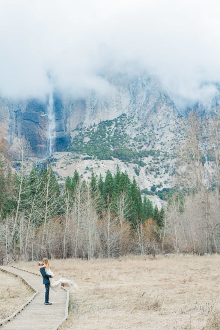 couple by Yosemite falls in the park