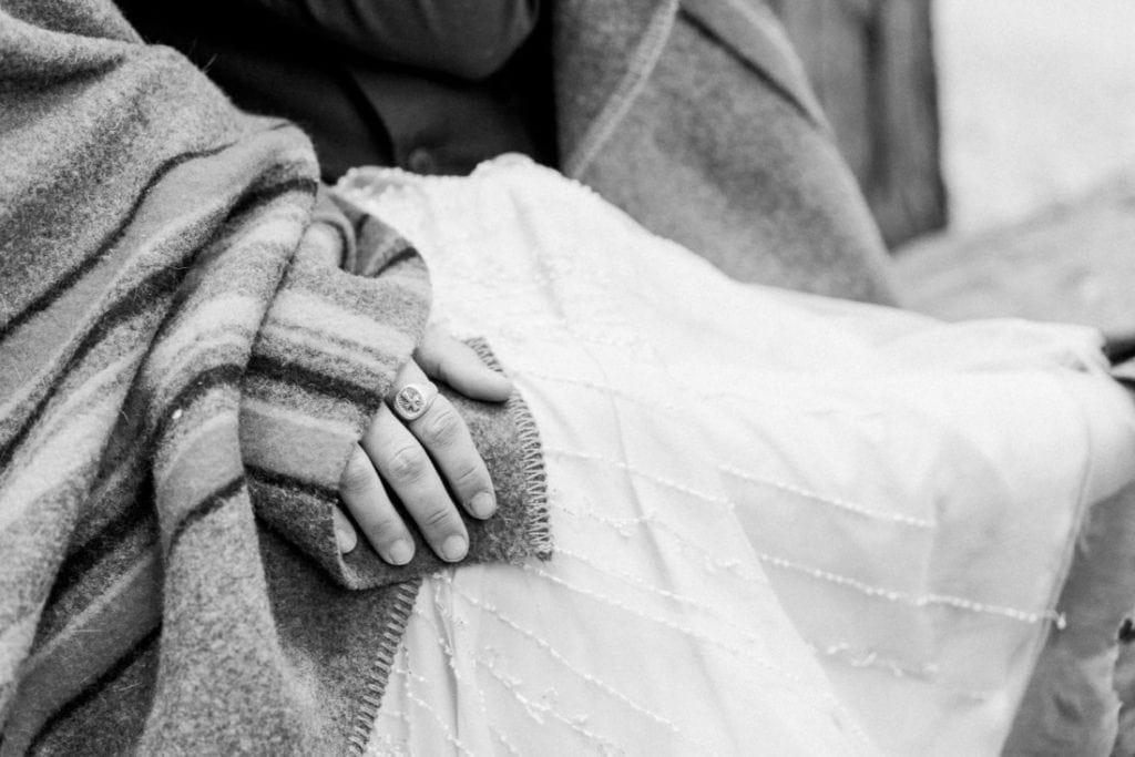 couple under a blanket in winter in Yosemite