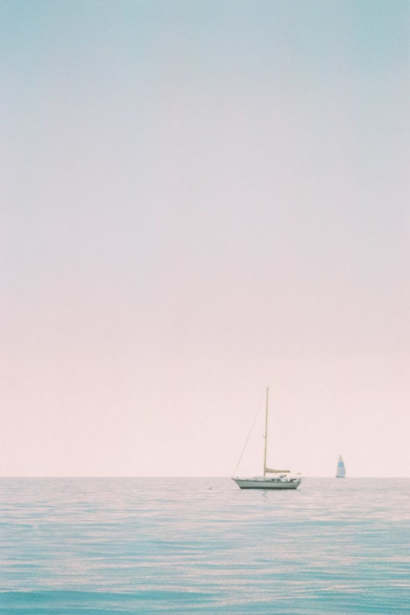 film photography on Fuji 400H of a sailboat in Santa Barbara, California in the ocean on the beach