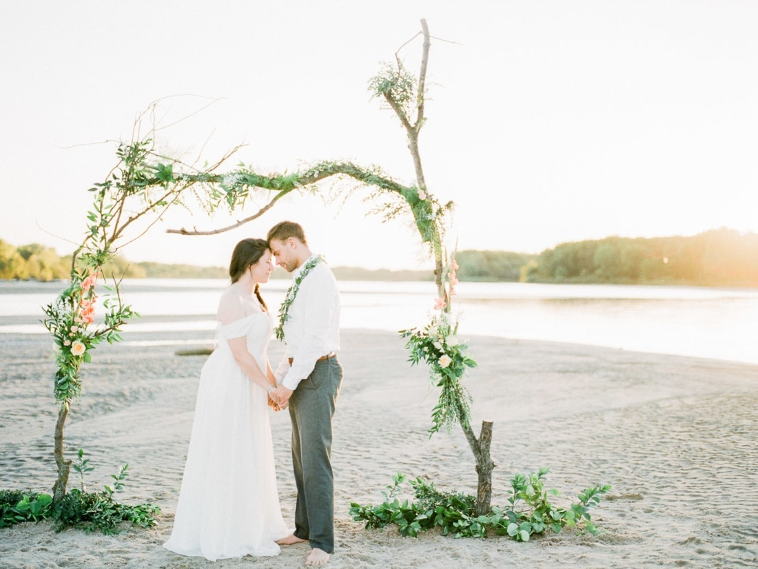 adventure elopement on a river with a floral arch made from driftwood | Nebraska elopement photographer