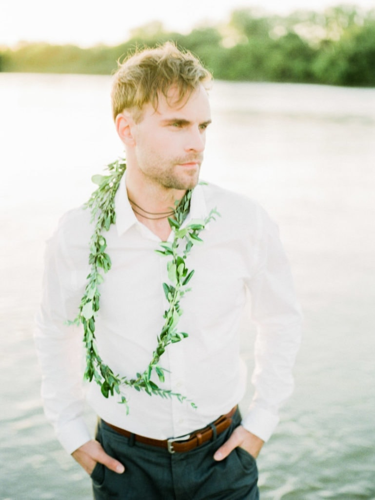 groom at an elopement on a river