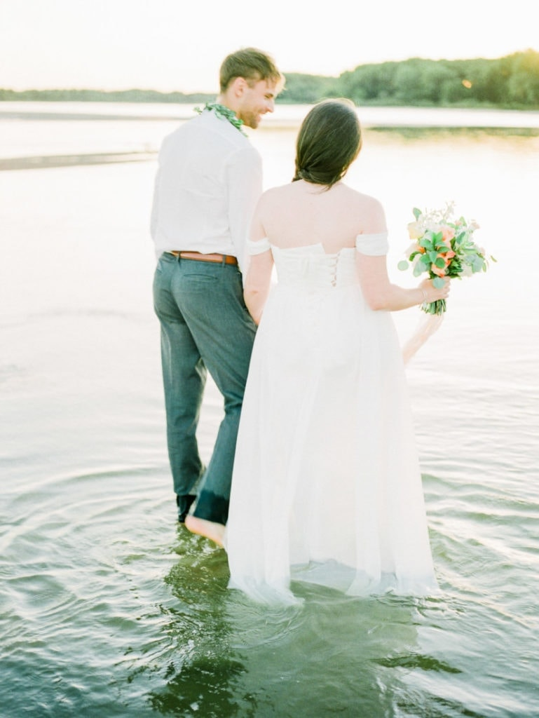 couple get in the water at their Nebraska elopement