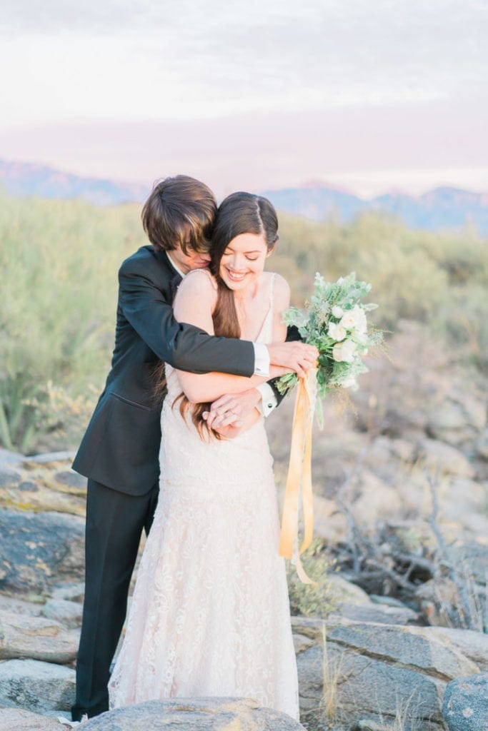 adventure wedding in the desert with the mountains in the background