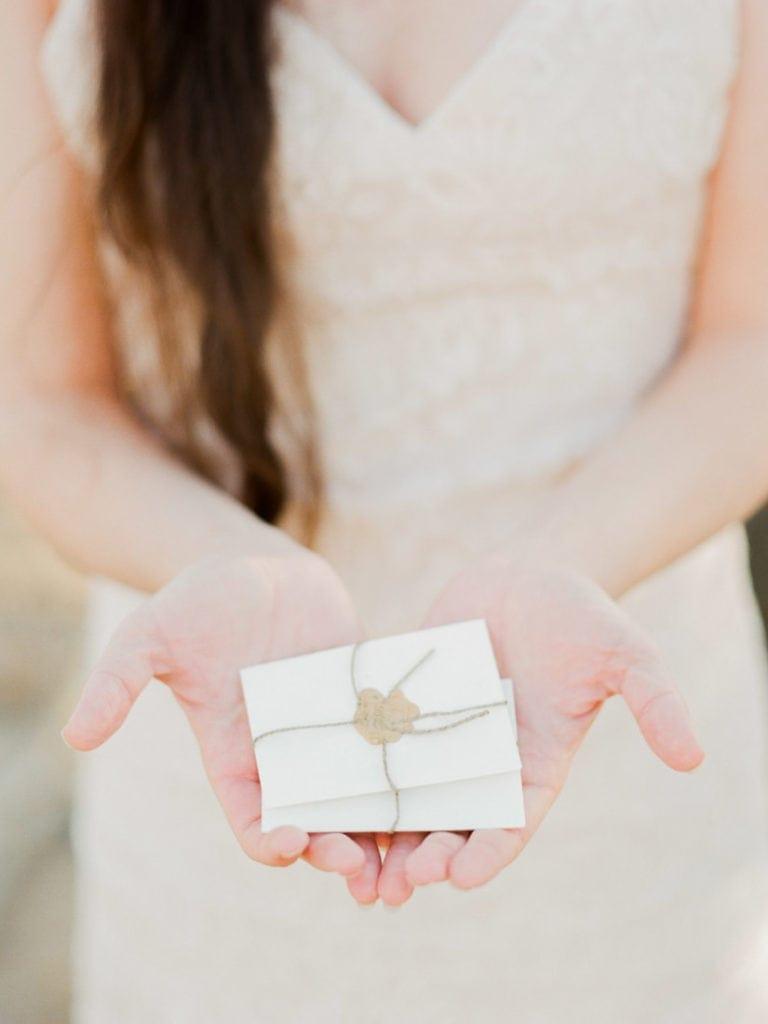 bride holding place cards