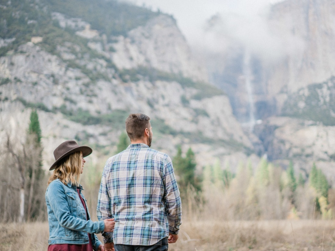 couple looking at Yosemite Falls on their photo session