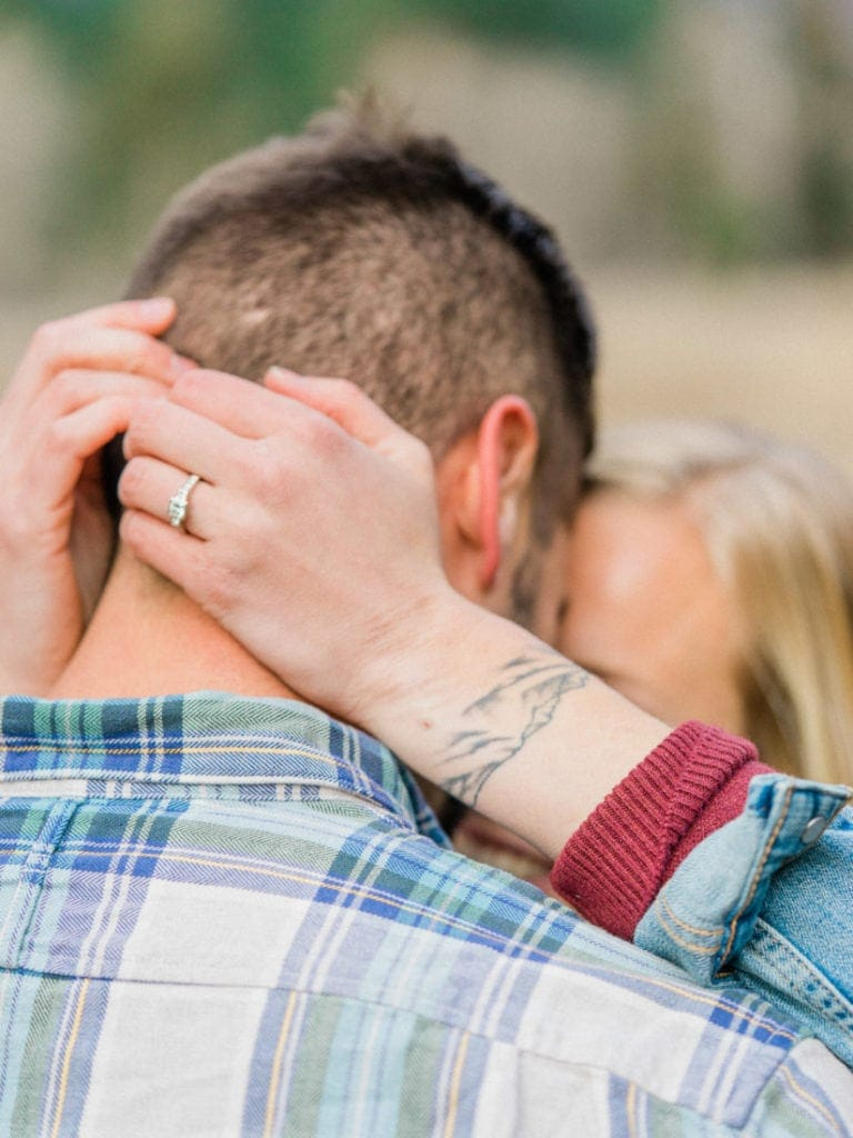 close up photo of a Catskills Mountains tattoo and engagement ring