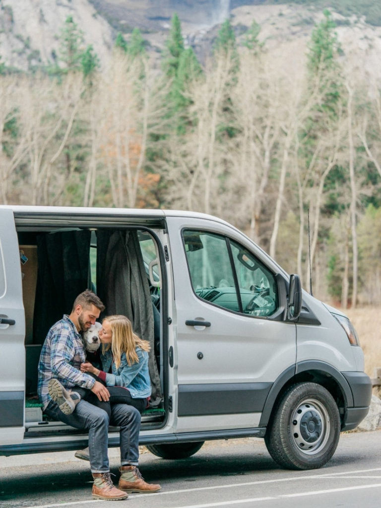 adventure session of a couple in their van with their dog in Yosemite