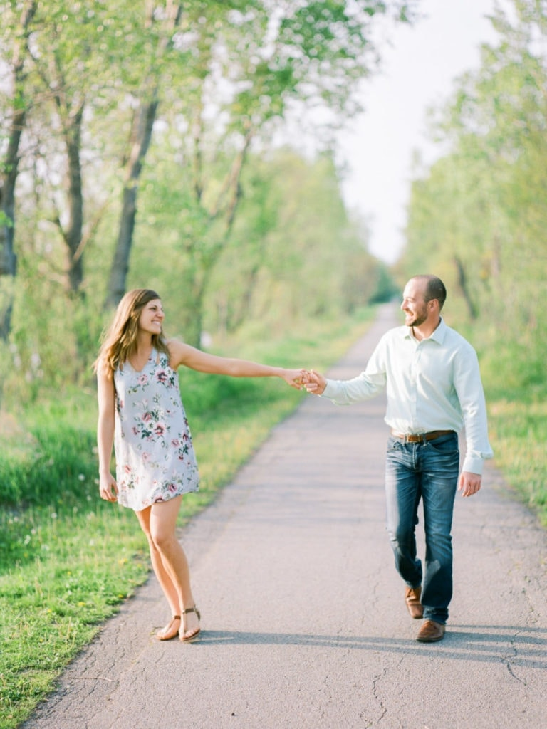 couple walking along a path in Chalco Hills
