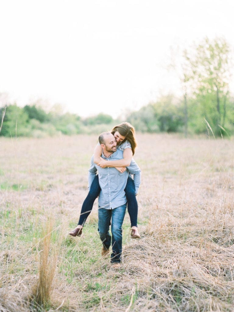 piggy back rides at an engagement session