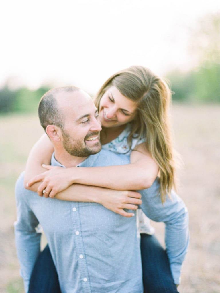 couple having fun at their engagement session