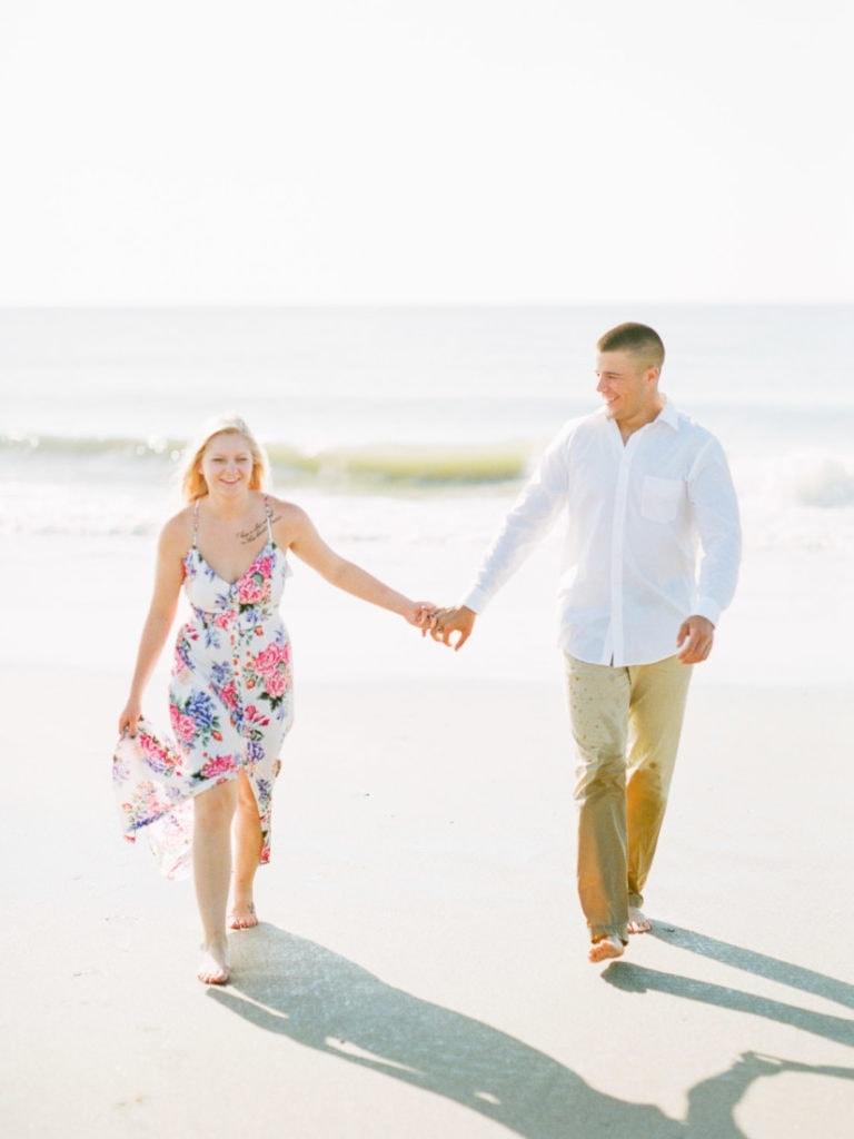 couples session on the beach with a floral dress in Savannah, GA