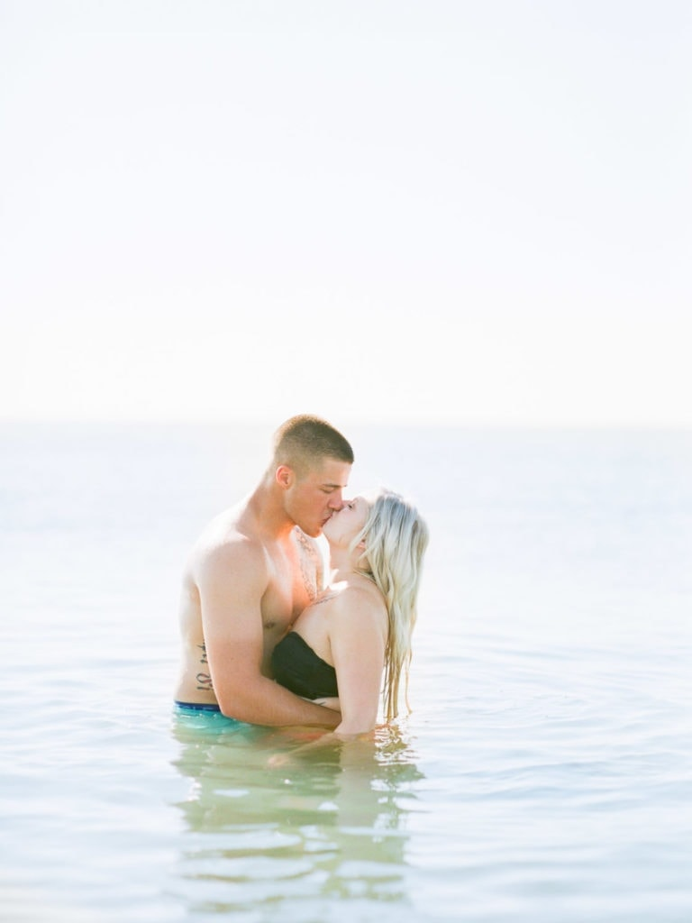 kissing in the ocean | couples engagement session at the beach