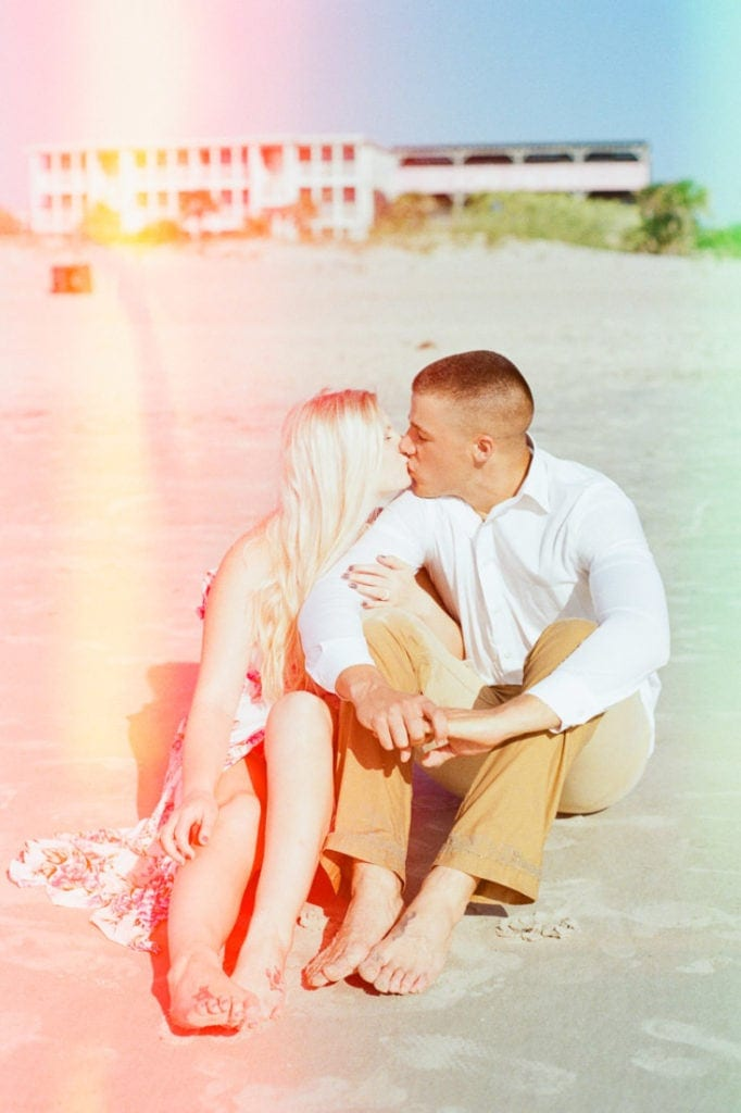 couple kissing on the beach in Georgia | light leaks and film burns