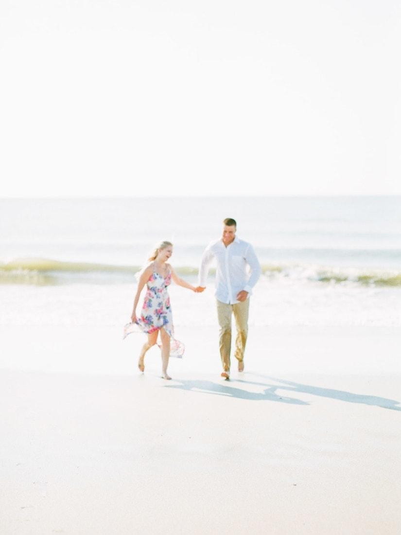 couple running on the beach at Tybee Island near Savannah, GA