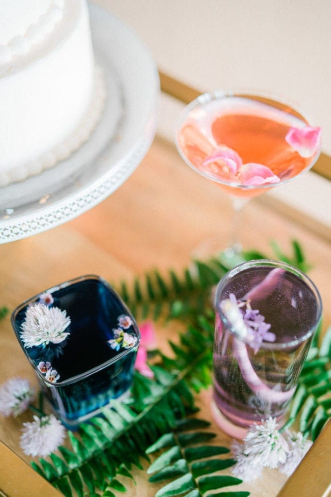 colorful wedding cocktails with flower petals