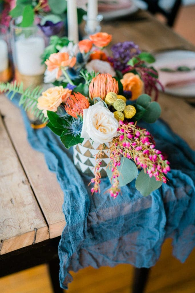 colorful centerpiece with blue gauze runner