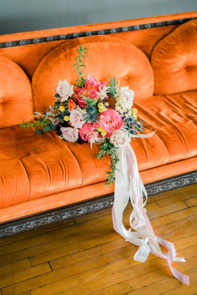 peony bouquet on a vintage orange couch