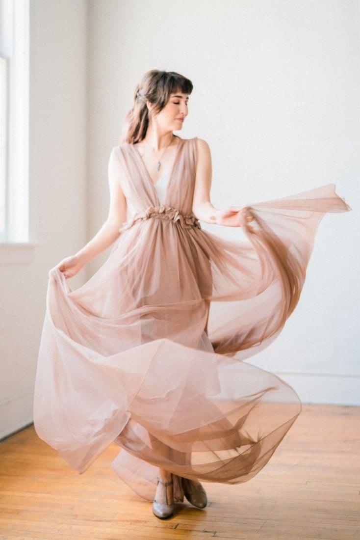 bride spinning in a blush boho wedding dress
