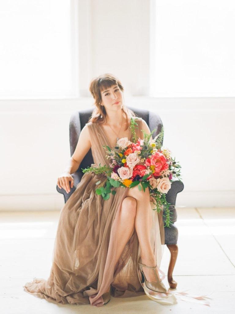 split V blush bridal dress and colorful florals