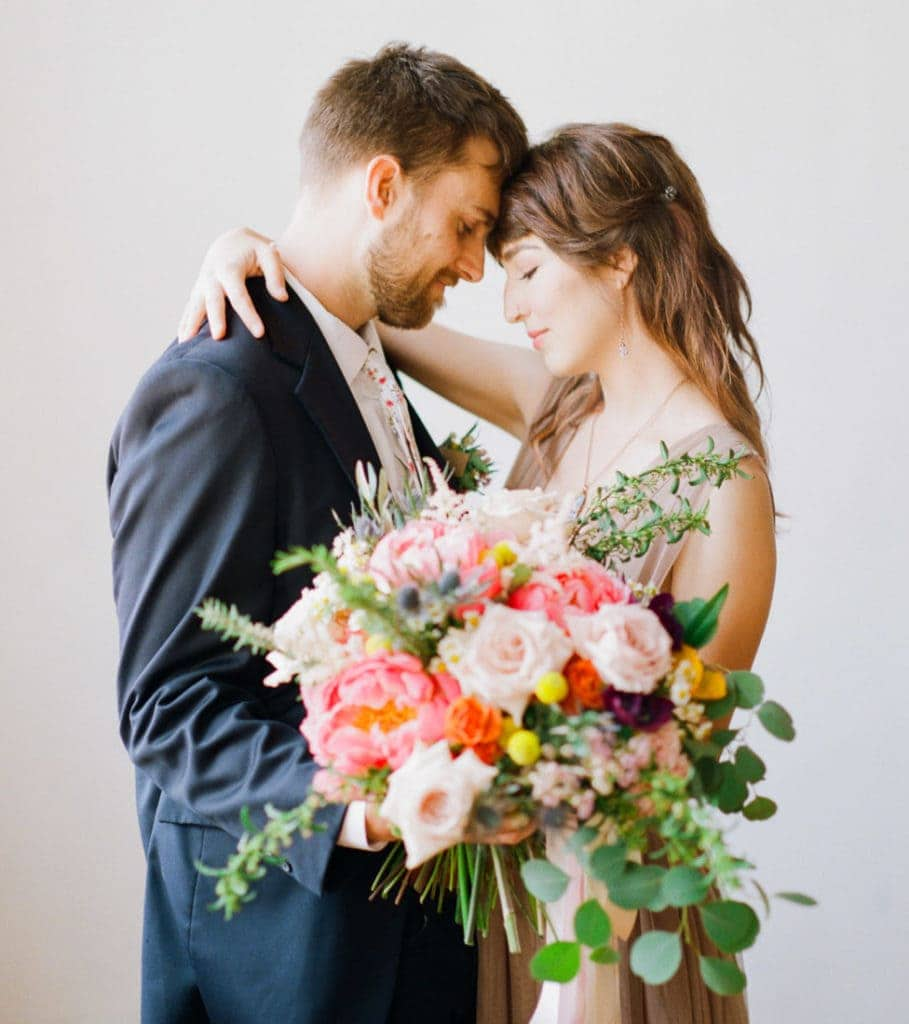 bride and groom with a colorful spring bouquet of peonies | Portra 800 film
