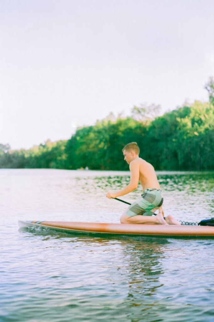 paddle boarding on a lake near Austin, Texas | Ektar 100 pushed +2