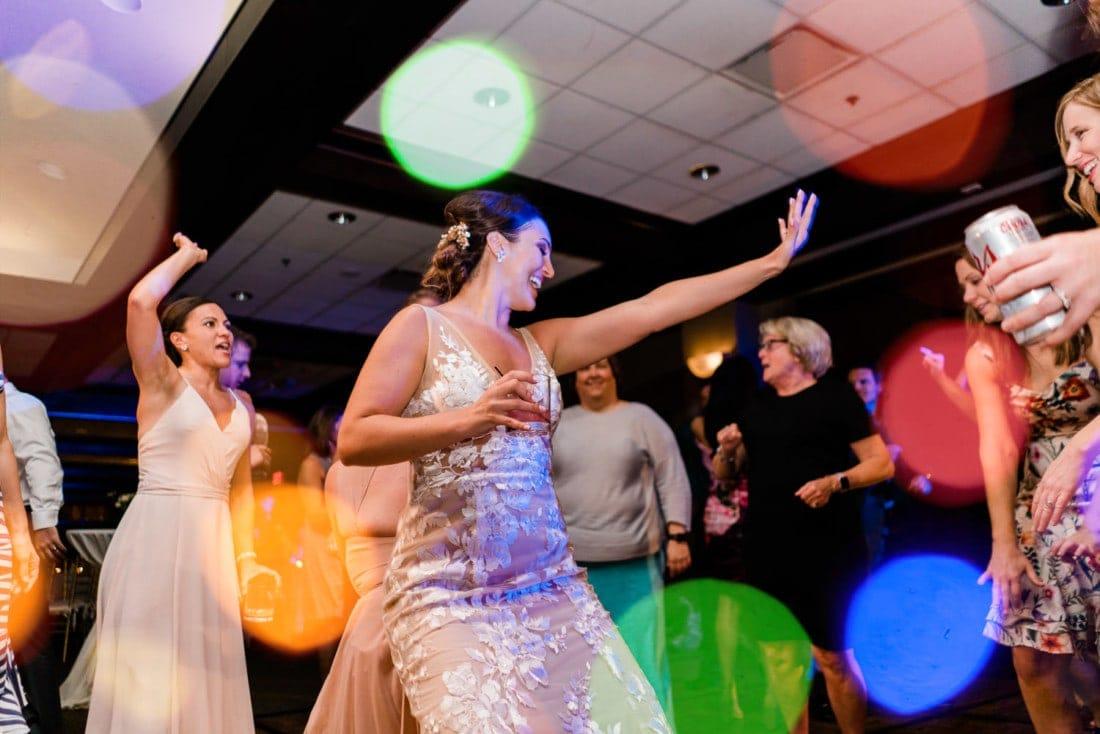 Bride dancing at a colorful wedding reception in Colorado.