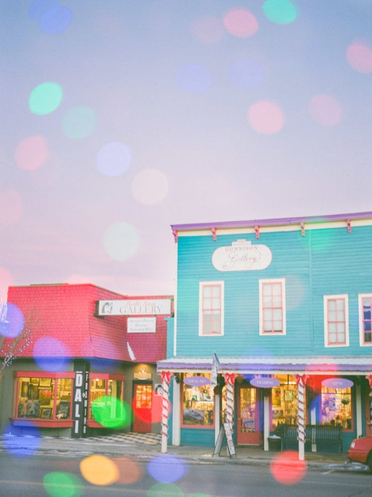 double exposure in Gunnison, CO with colorful buildings and holiday lights