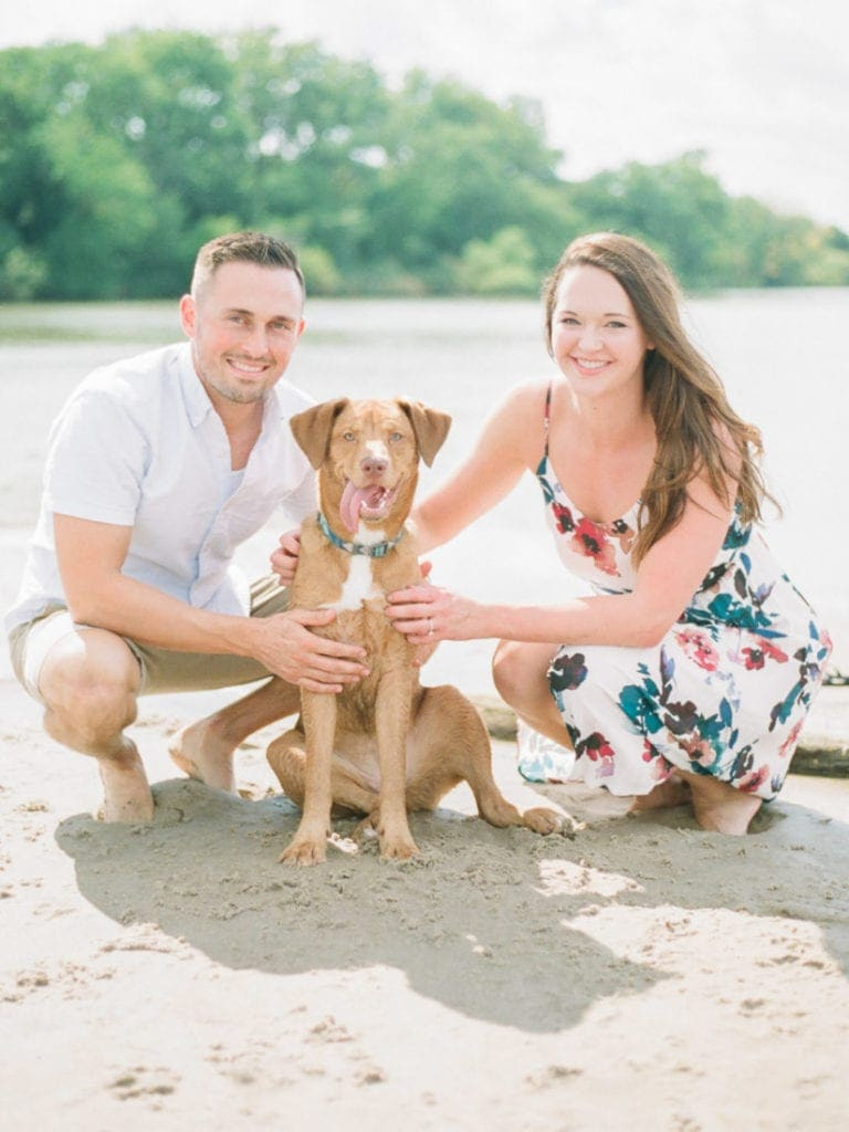 couples session on the river with their dog