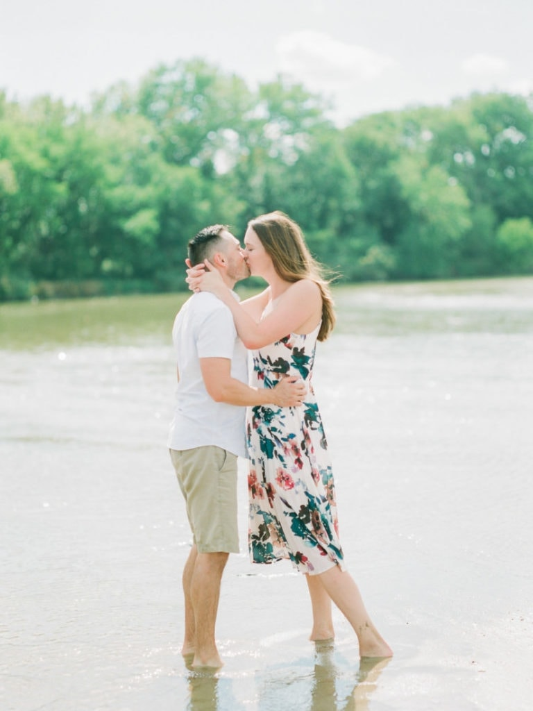 couple kissing on the river