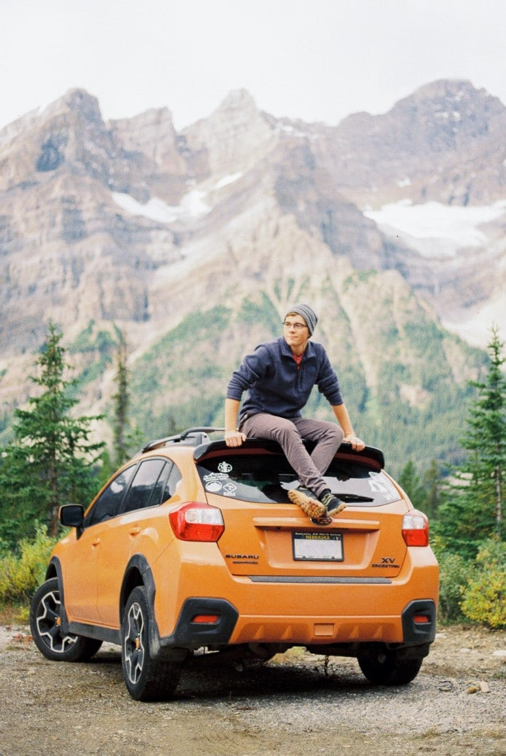 portrait of Malachi Lewis with his Subaru | an adventure wedding photographer & elopement photographer in Colorado