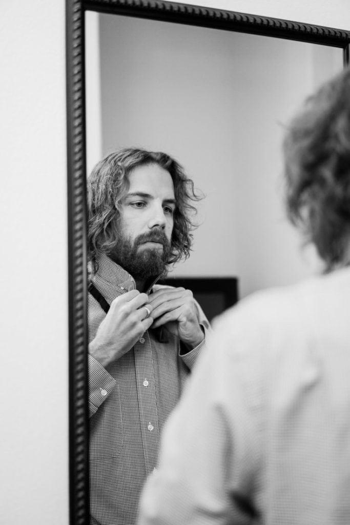 groomsman getting ready at a wedding in Colorado