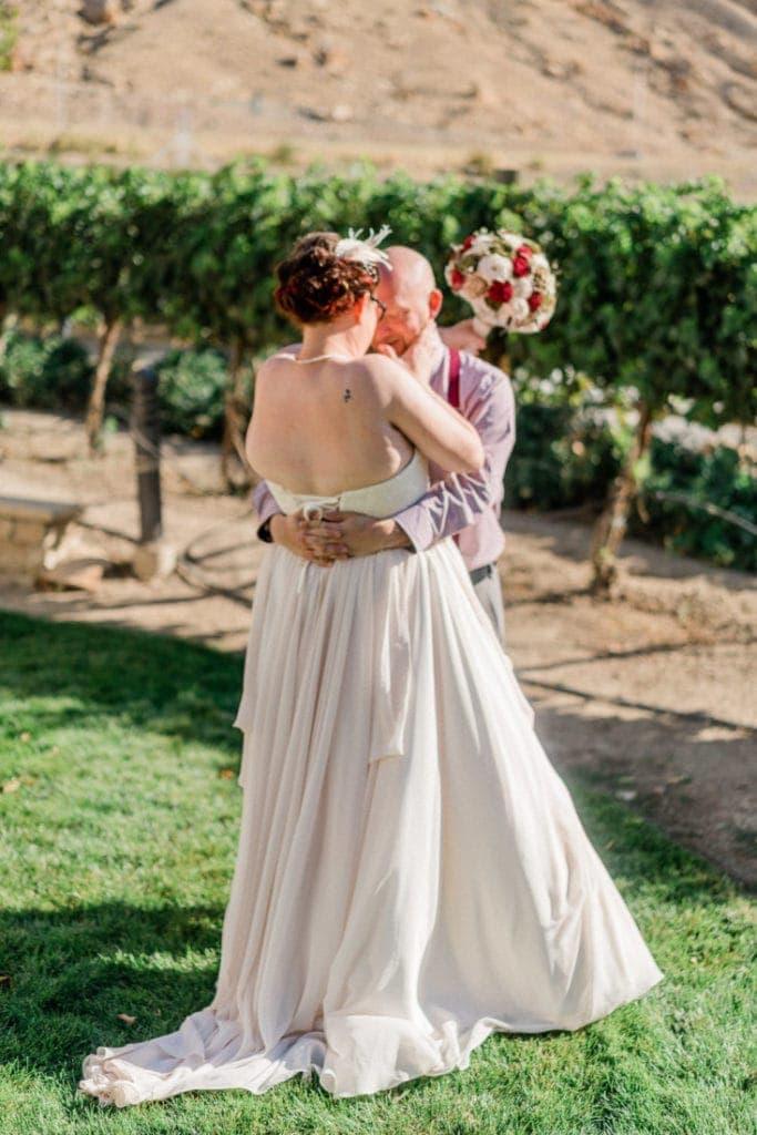 first look in a vineyard | Colorado wedding photographer