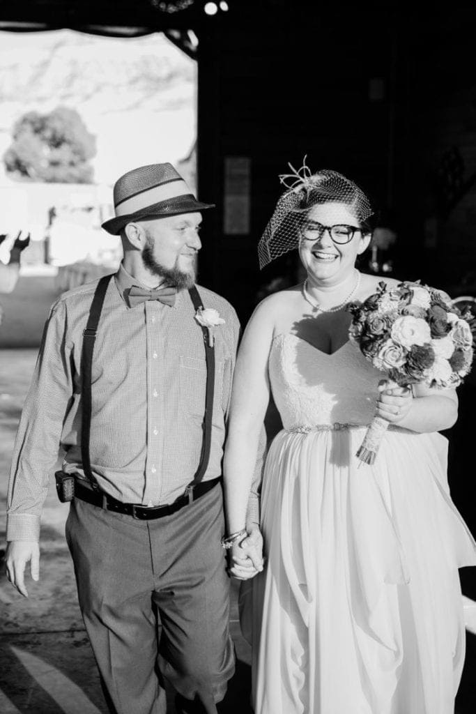 black and white photography of a bride and groom at their reception