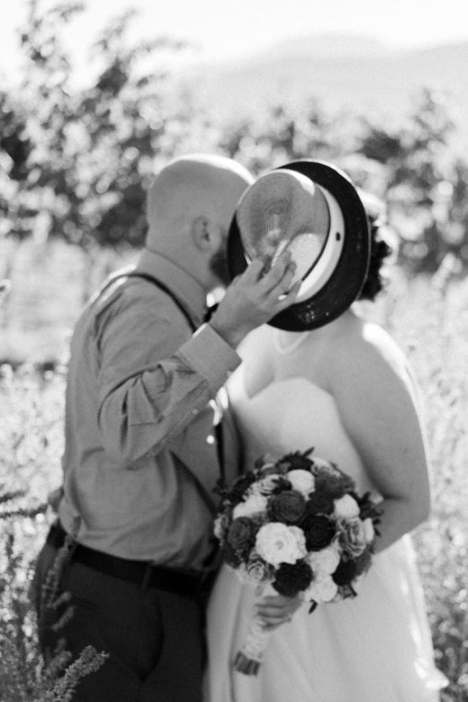 black and white photography of a couple at their wedding