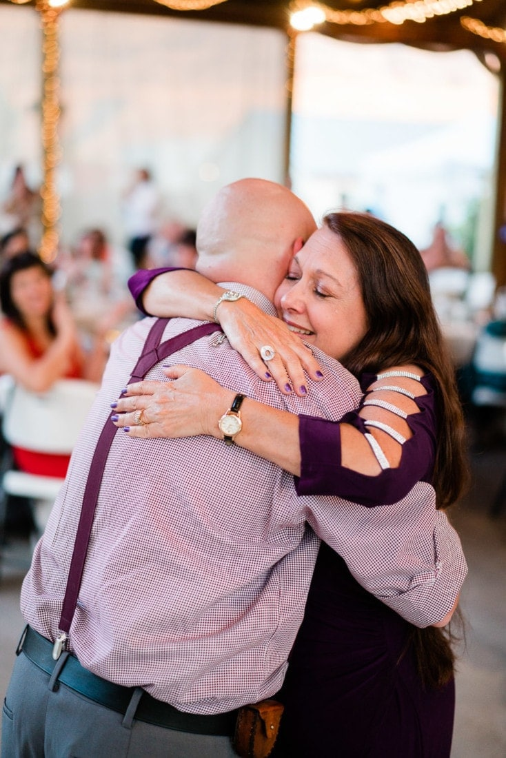 mother of the groom hugging her son at a wedding in Palisade, CO