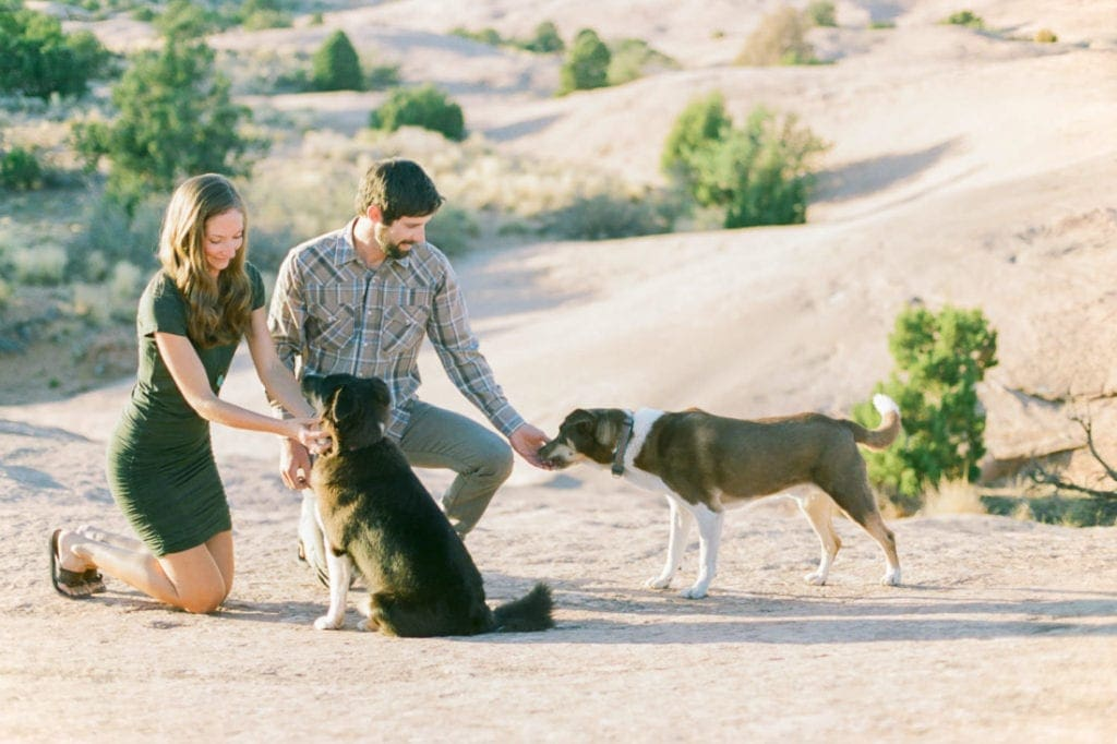 a couple and their dogs in Moab | adventure session