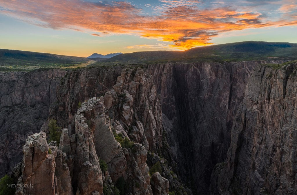 sunset at Black Canyon of the Gunnison National Park with the West Elk Mountains in the background
