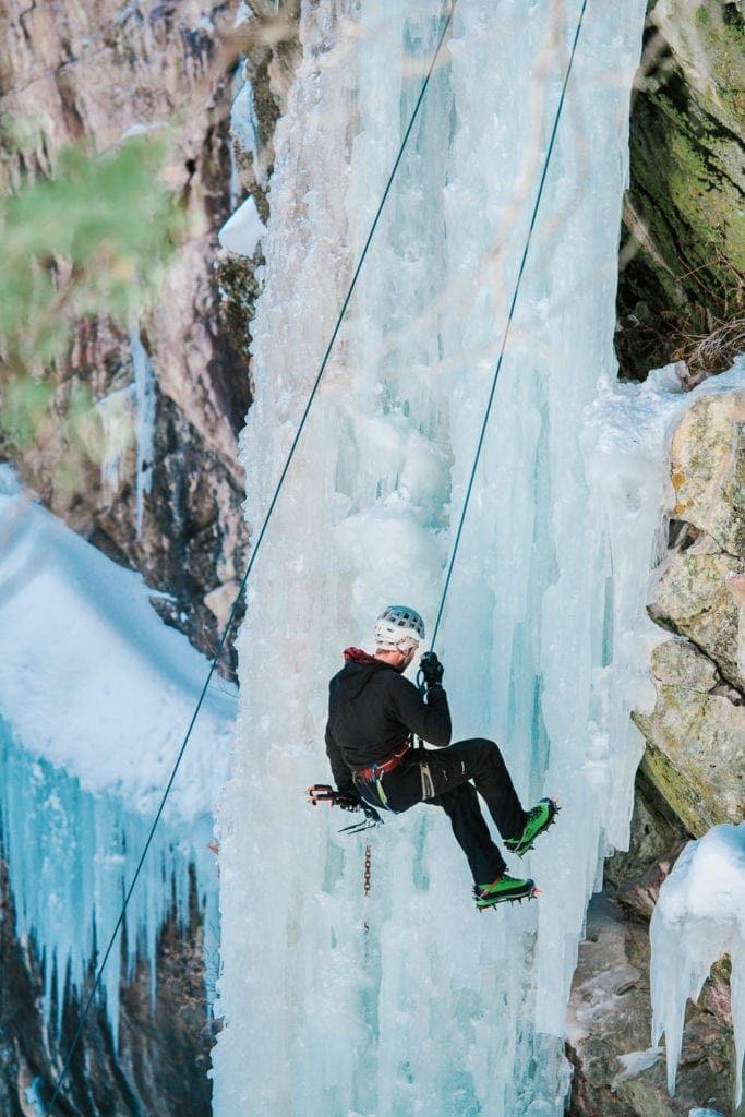 ice climber repelling down the gorge in Ouray
