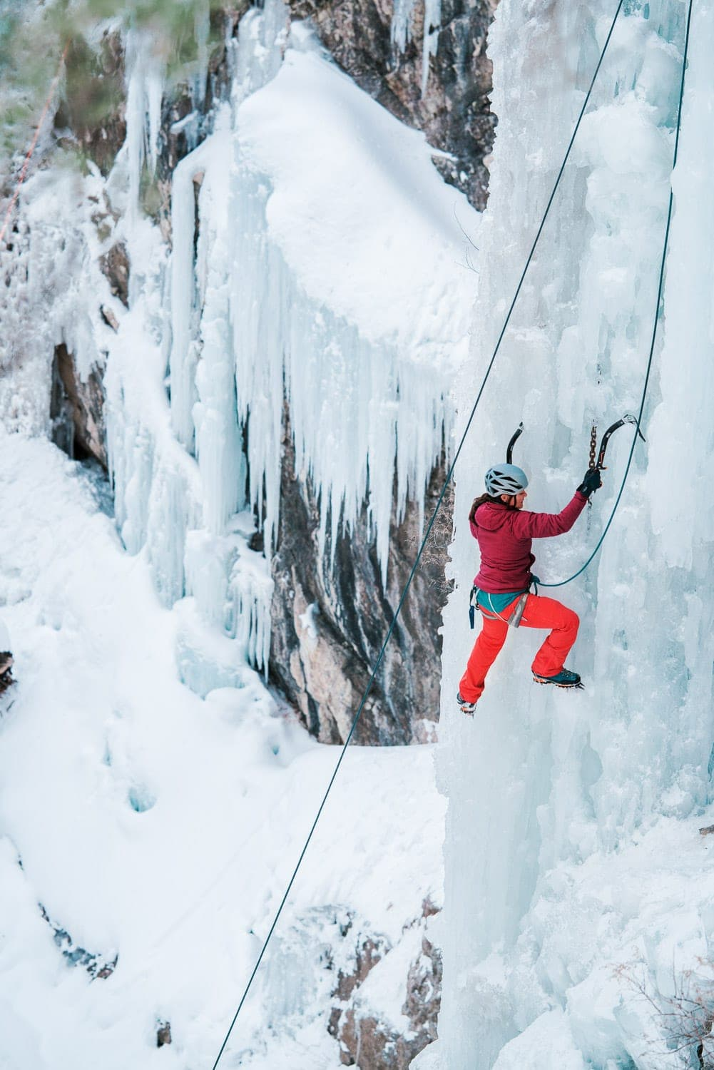ice climbing in the Ouray Ice Park along the wall of the gorge