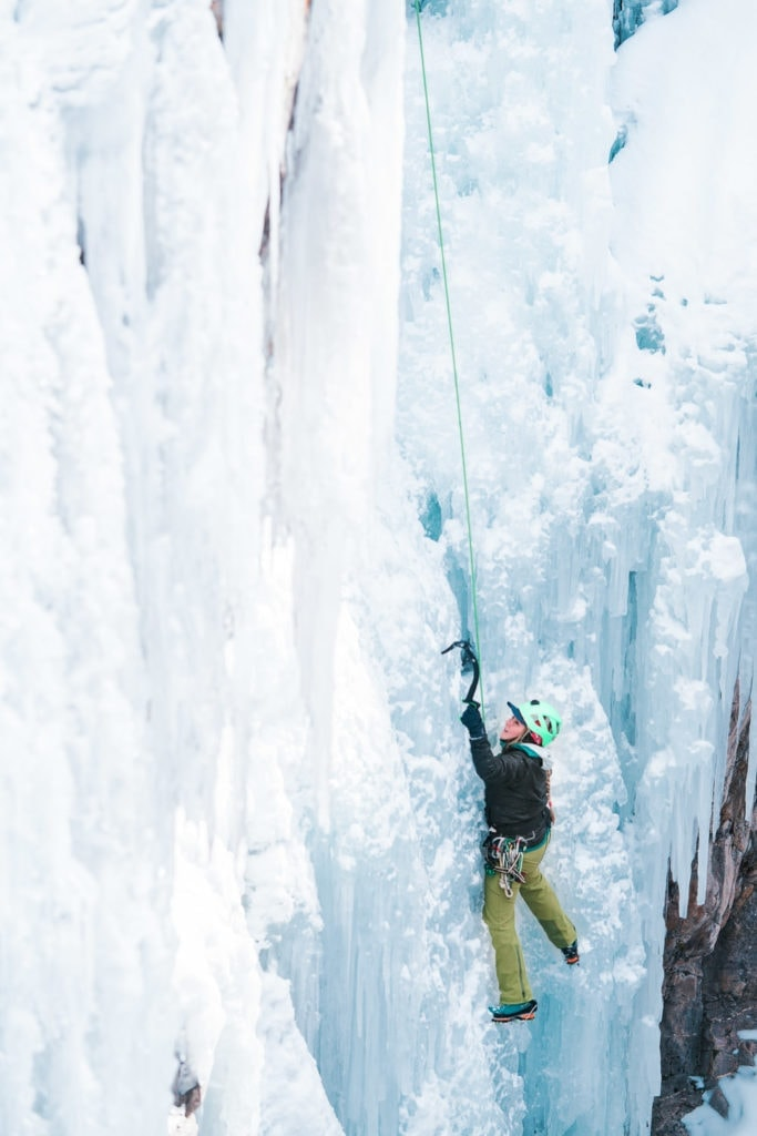 woman climbing the ice in the Ouray Ice Park