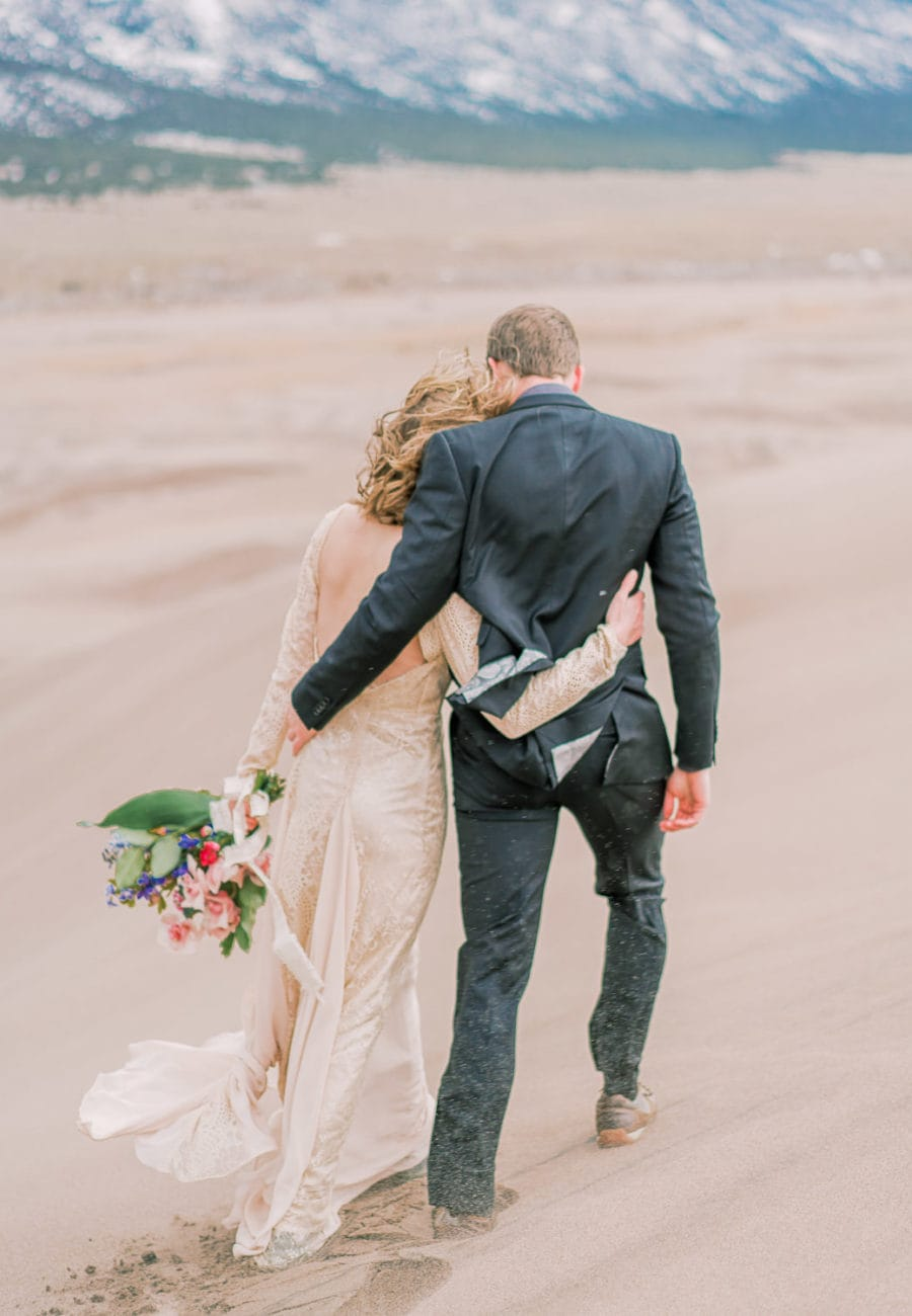 adventure hiking elopement in the sand dunes in Colorado
