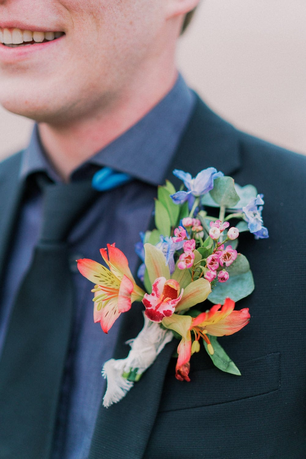 cymbidium orchid boutonniere on a groom's lapel during an elopement