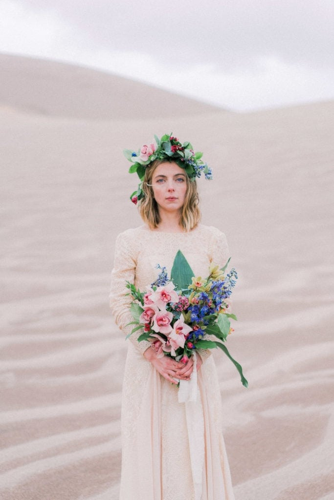 bride on her elopement with tropical flowers and a flower crown